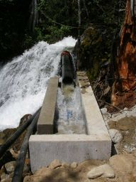 A coanda screen and drop type intake supplies 50 liters per second to a 6 inch penstock, 6000 feet long with 1500 feet of total fall.