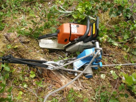 This small chain saw head attached to a capstan winch. We used a 500 foot long length of 3/8 nylon rope to pull the pipe up the hill.