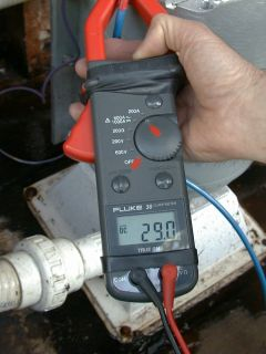 Clamp on DC meter reading 29 amps at 28 volts, for 812 watts of clean micro hydro energy..