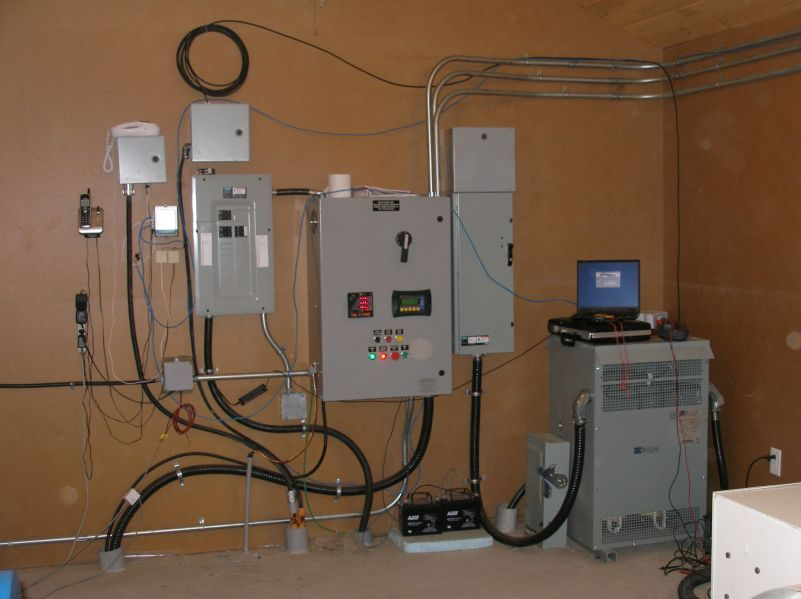 From right to left, 75 kVA  240 to 600 volt transformer, main disconnect, governor control panel, distribution breakers, fiber optic terminus, head level control.