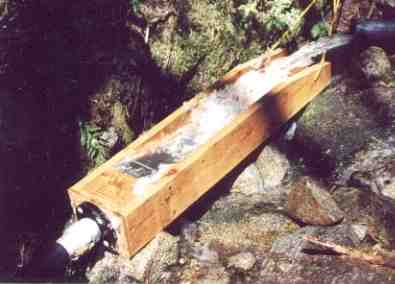 A portable self cleaning intake built into a wooden floom.