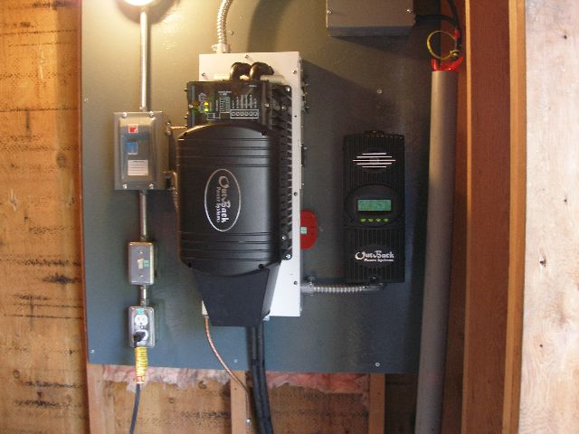 The power panel in the shed with 3500 watt outback inverter.