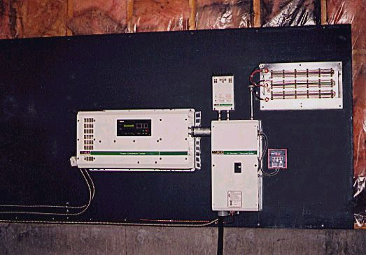 A Trace Engineering 4000 watt, 24 volt sine wave inverter and control panels.