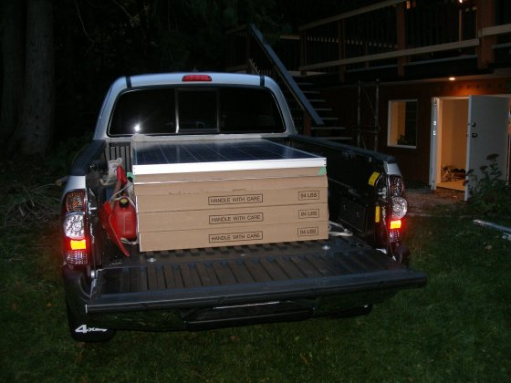 Homepower making delivery of 9 Sharp modules.