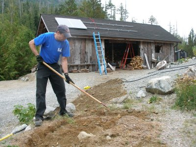 Paul Gallaway of Gallaway Electric in Ucluelet BC finishing trench for cable