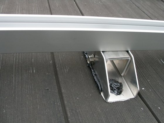 Rail roof mounting feet caulked